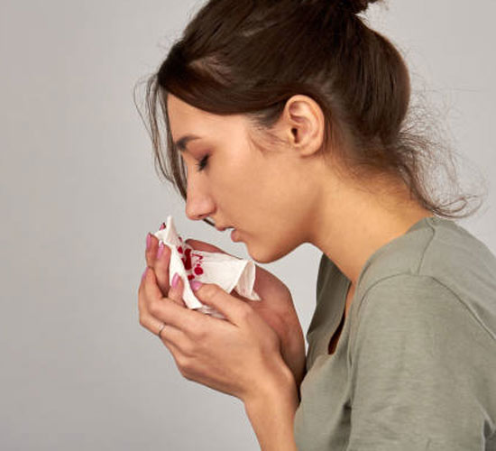 Teenage girl with bloody nose from drug use